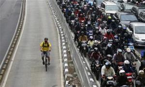 Bike past traffic jam.  Reuters